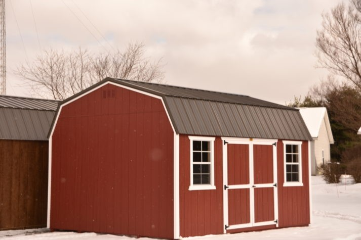 Utility Lofted Barn 12x16 Rustic Red with White Trim Bronze Metal